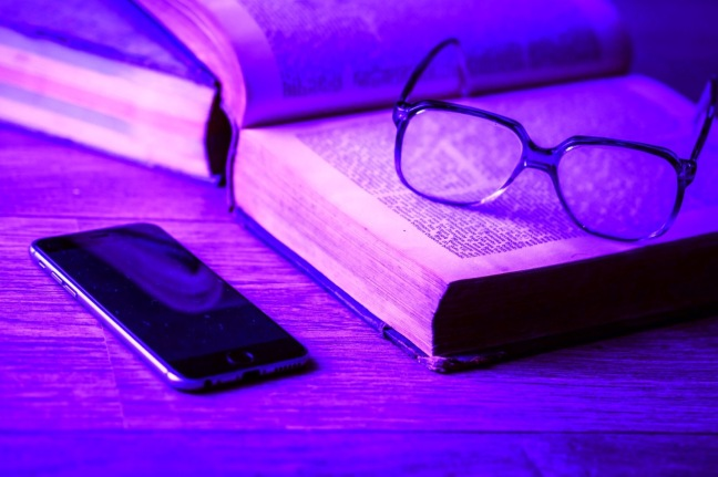 Image of book and phone