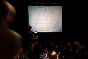 Madame Lark shows an overhead slide of Caxton's original home in Paddington