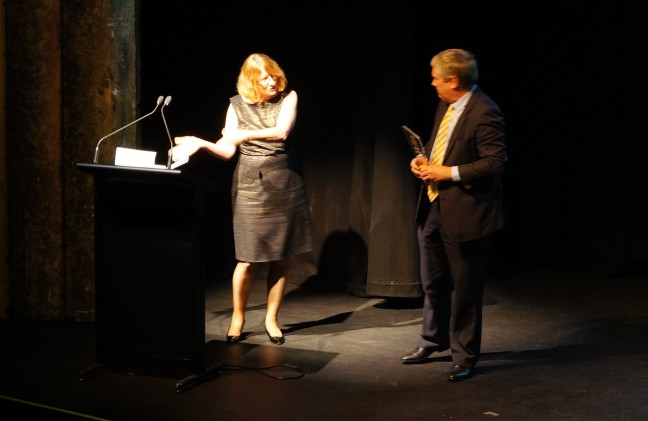 Michael Cope receiving his award from Chief Justice Catherine Holmes