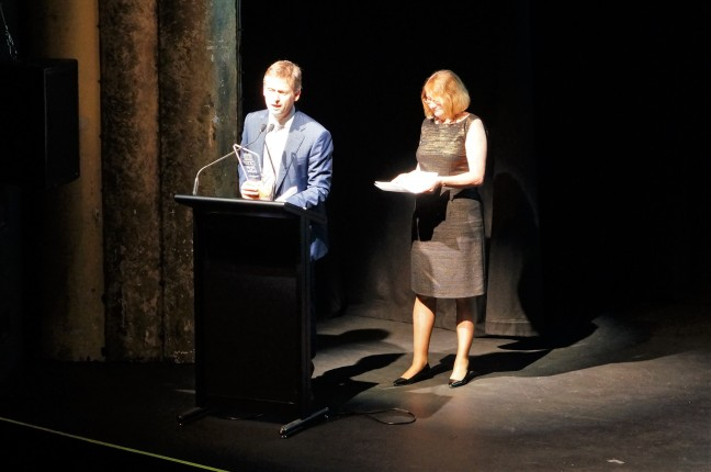Scott McDougall receiving Robert Stevenson's award from Chief Justice Catherine Holmes